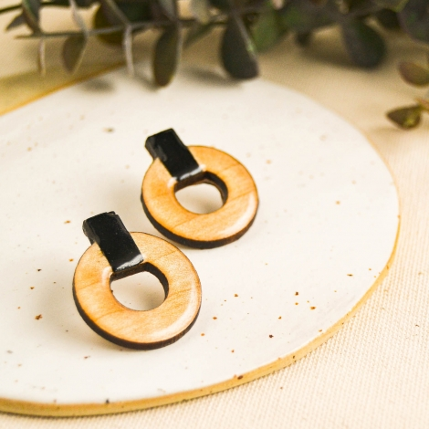 Round statement earrings and black side hoops